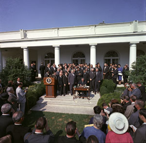 Lyndon B. Johnson speaking in front of a crowd